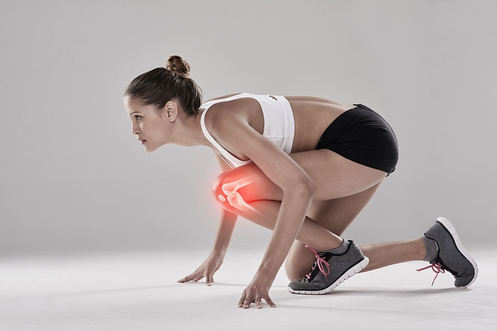 Studio shot of an athlete with an injury highlighted in glowing red